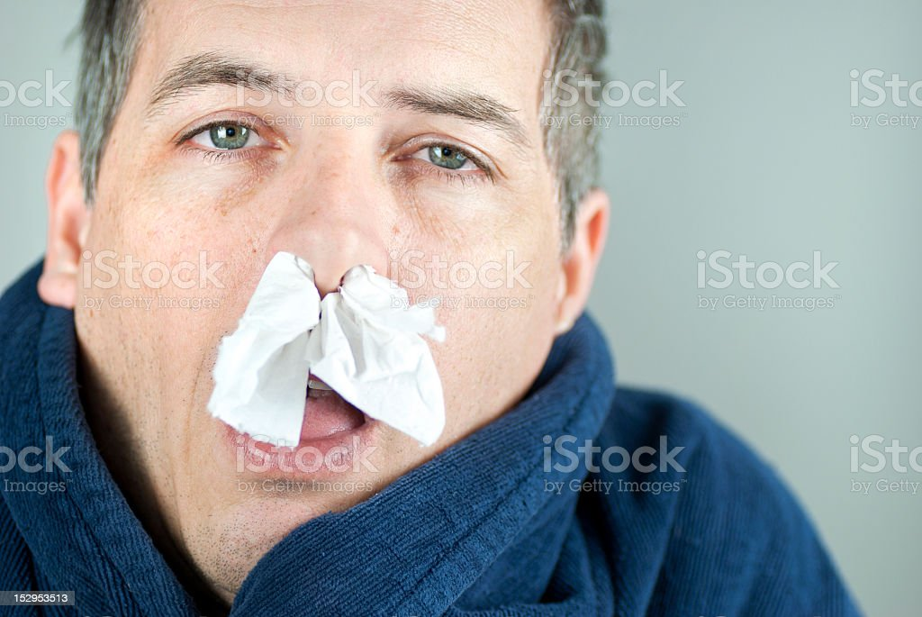 Man With Tissue In Nose royalty-free stock photo