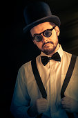 istock Man with Top Hat and Steampunk Glasses Retro Portrait 500525313