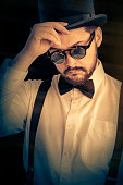 istock Man with Top Hat and Steampunk Glasses Retro Portrait 500525329