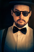 istock Man with Top Hat and Steampunk Glasses Retro Portrait 507683581
