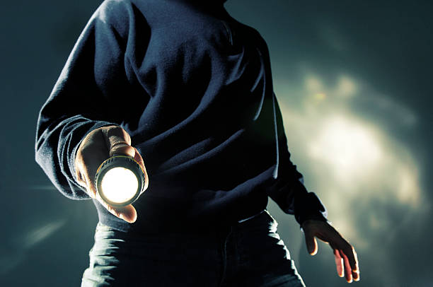 man with torch at night stock photo