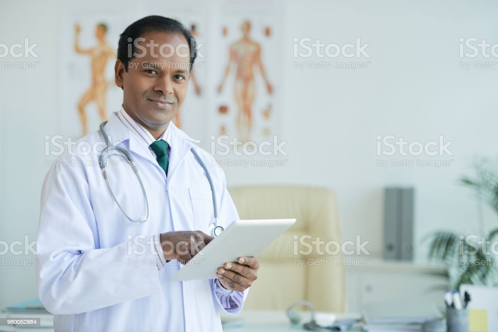 Man with touchpad stock photo