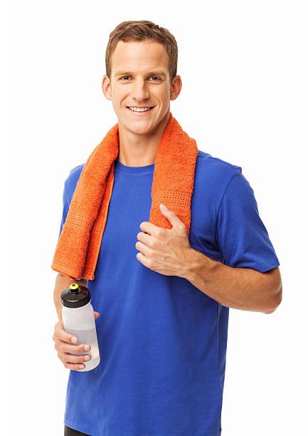 mann mit handtuch und eine flasche wasser isoliert - hals übungen stock-fotos und bilder