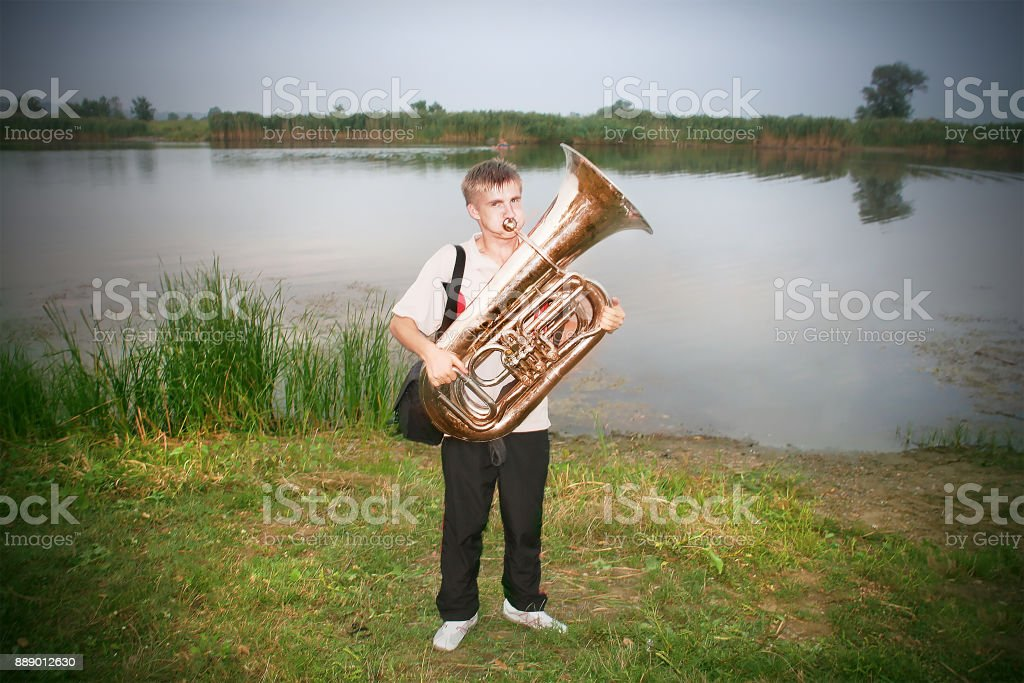 Man with trombone pipe stock photo