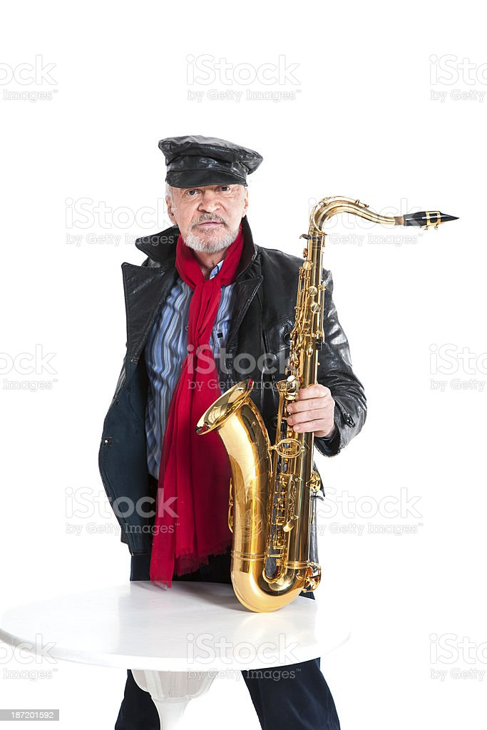 man with trumpet near the table stock photo