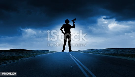 istock Man with trumpet 518563229