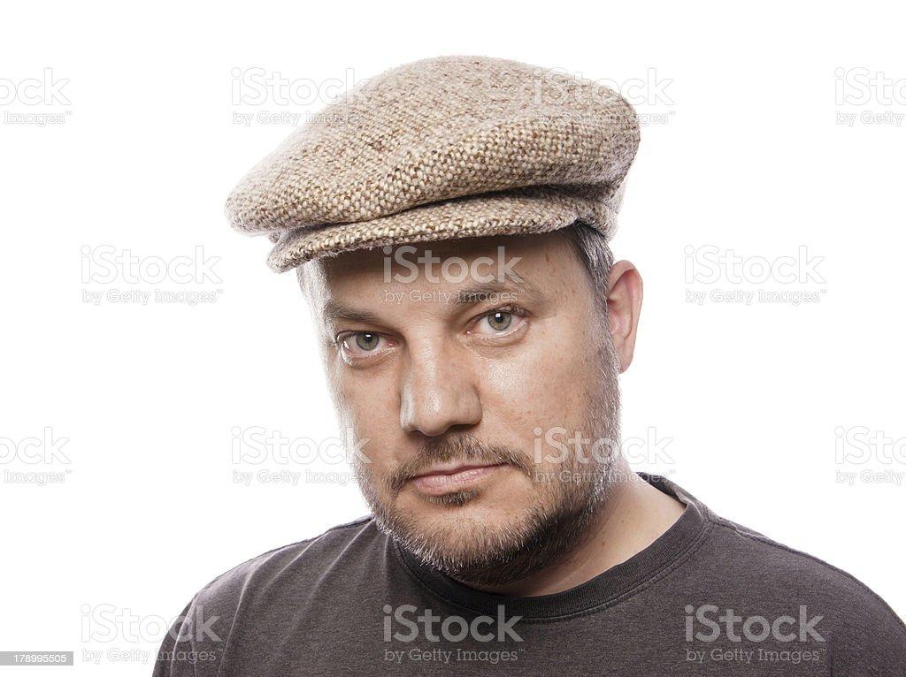 man with tweed cap stock photo