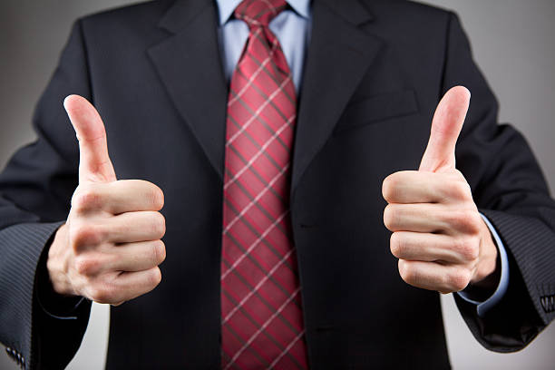 Man with two thumbs up stock photo