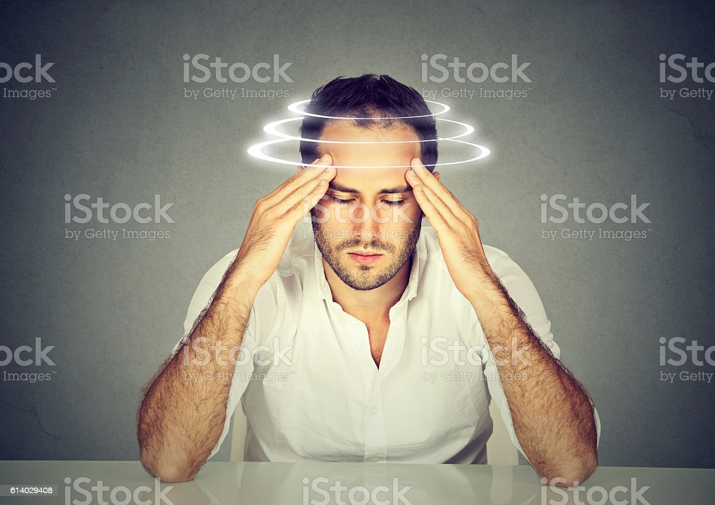 Man with vertigo. Patient suffering from dizziness. stock photo