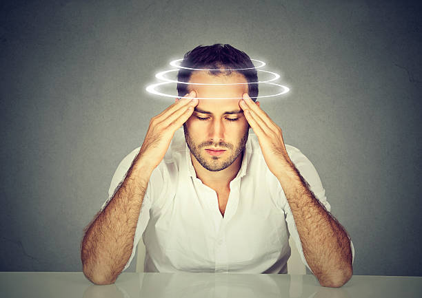 man with vertigo. patient suffering from dizziness. - höhenangst stock-fotos und bilder