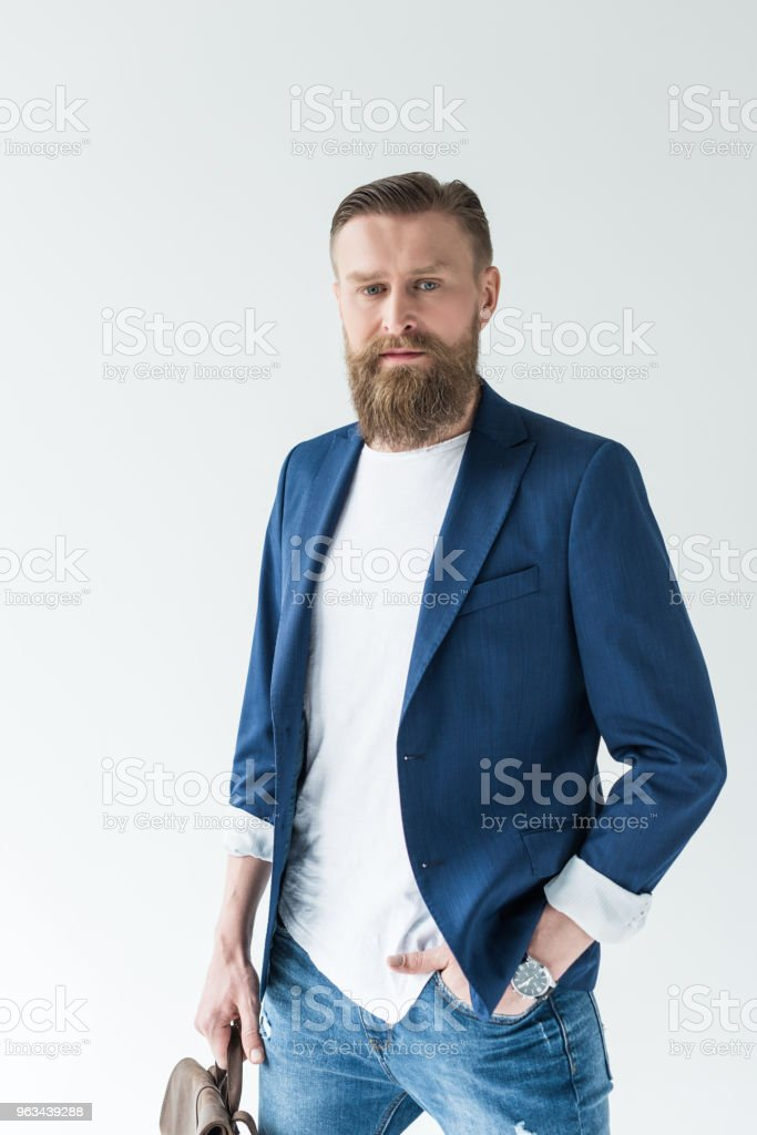 Man with vintage mustache and beard holding backpack isolated on light background - Zbiór zdjęć royalty-free (Broda)