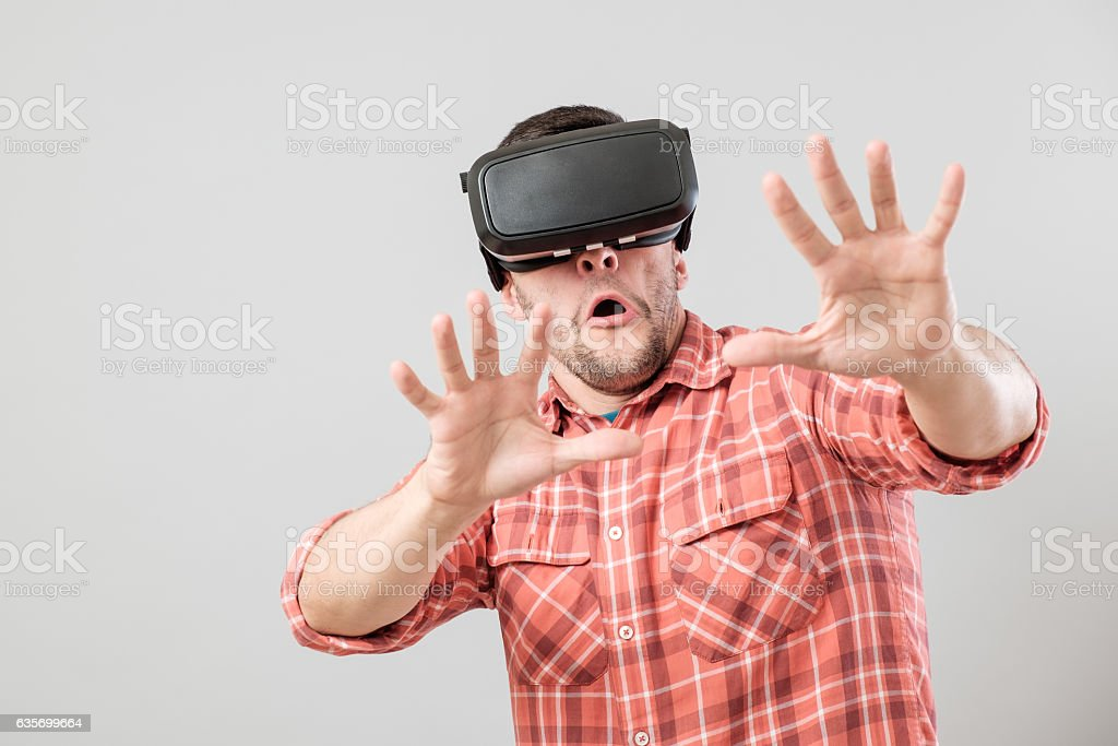 Man with virtual reality glasses showing gesture royalty-free stock photo
