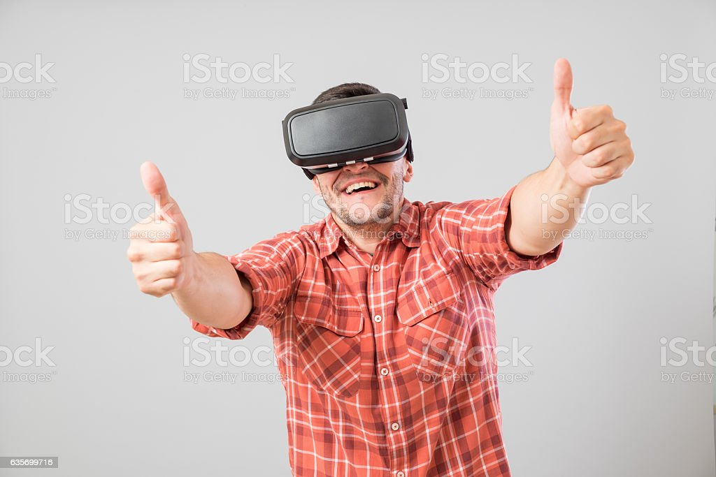 Man with virtual reality glasses showing thumb up royalty-free stock photo