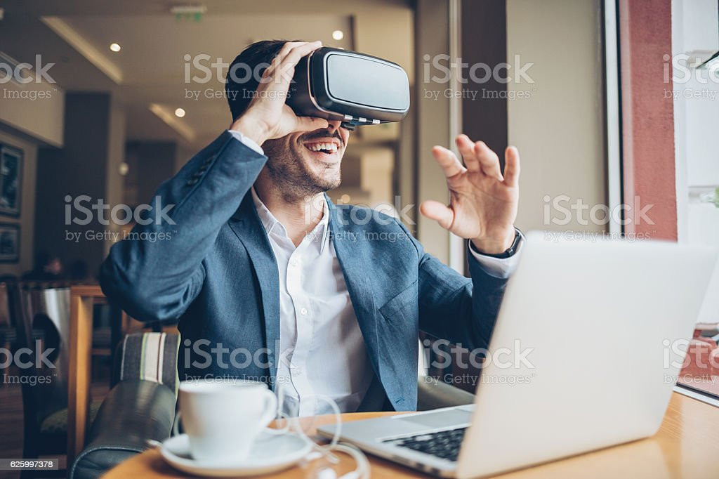 Man with virtual reality headset stock photo