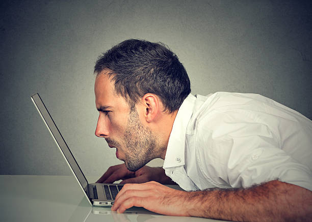 man with vision problems using computer reading email stock photo