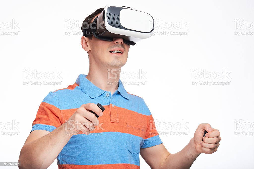 Man with VR glasses and controllers Lizenzfreies stock-foto