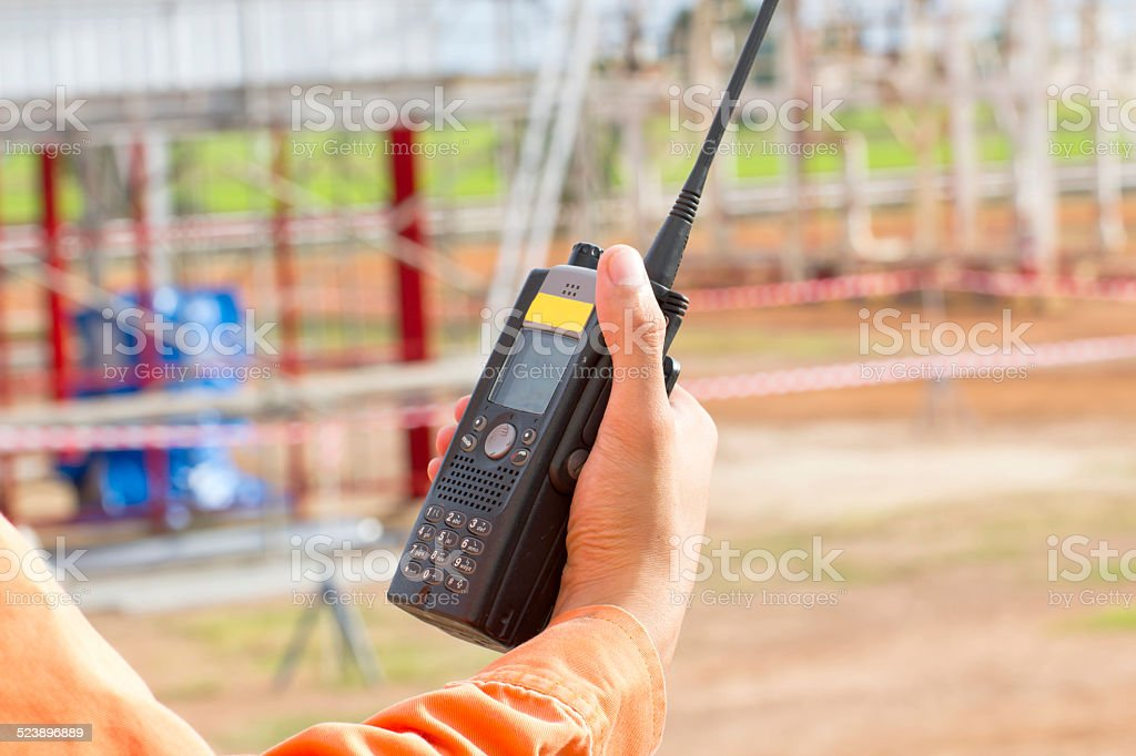 man with walkie talkie for outdoor stock photo