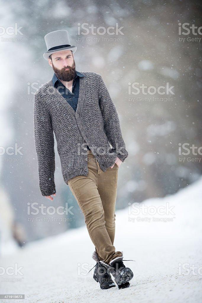 Man with walking through the Snow, Winter Fashion stock photo