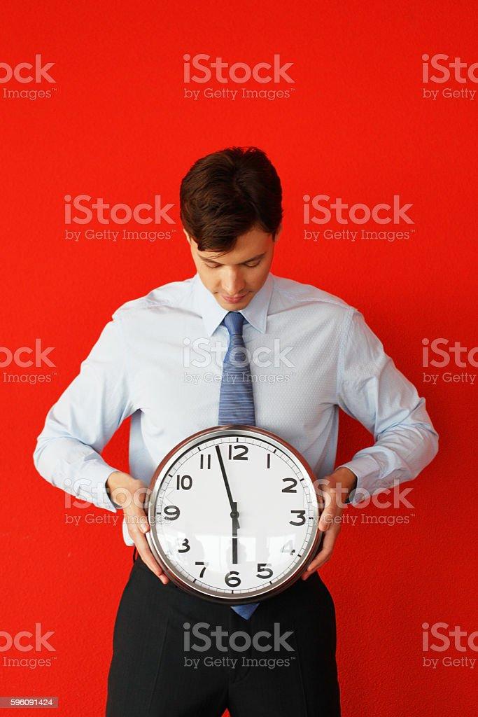 Man with wall clock royalty-free stock photo