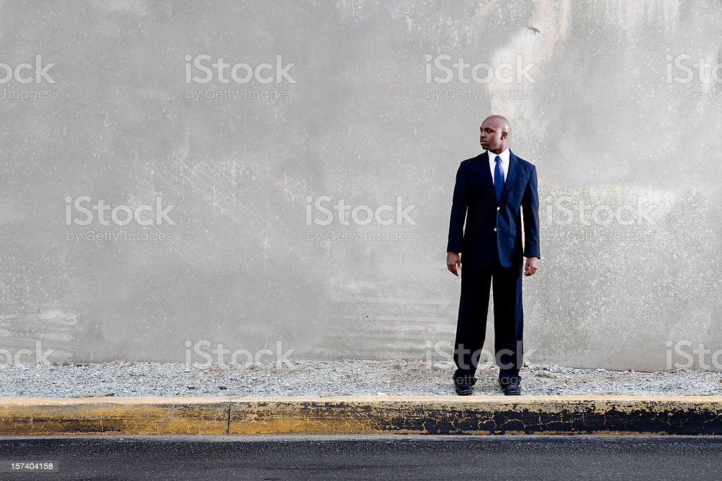 Man with wall stock photo