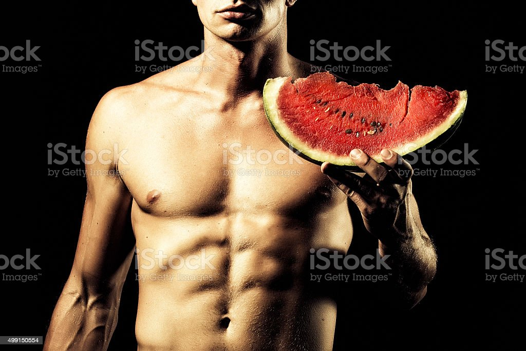 Man with water melon stock photo