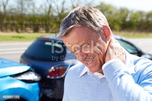 istock Man with whiplash after traffic collision 455681155