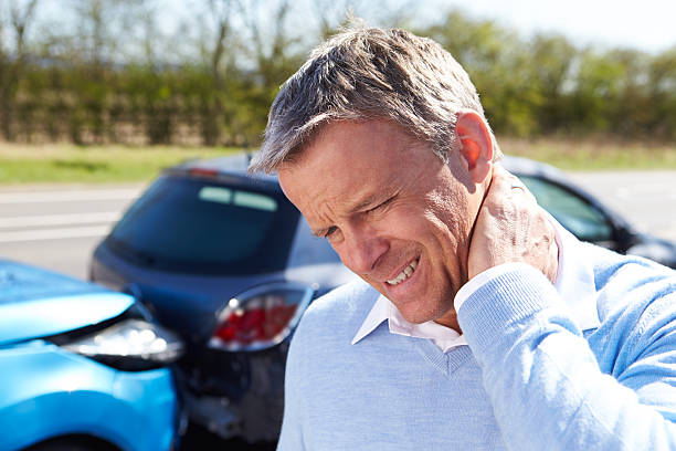 Man with whiplash after traffic collision stock photo