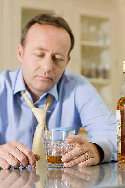 Man with whisky stock photo