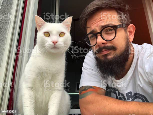 Man with white cat on the window picture id970732924?b=1&k=6&m=970732924&s=612x612&h=9wh892dn1bitodj8uedexlfhq qcv9wfufl mqokv4e=