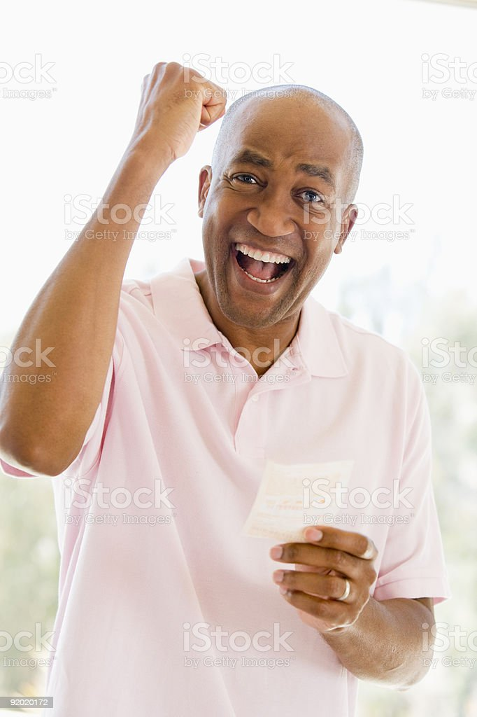 Man with winning lottery ticket stock photo