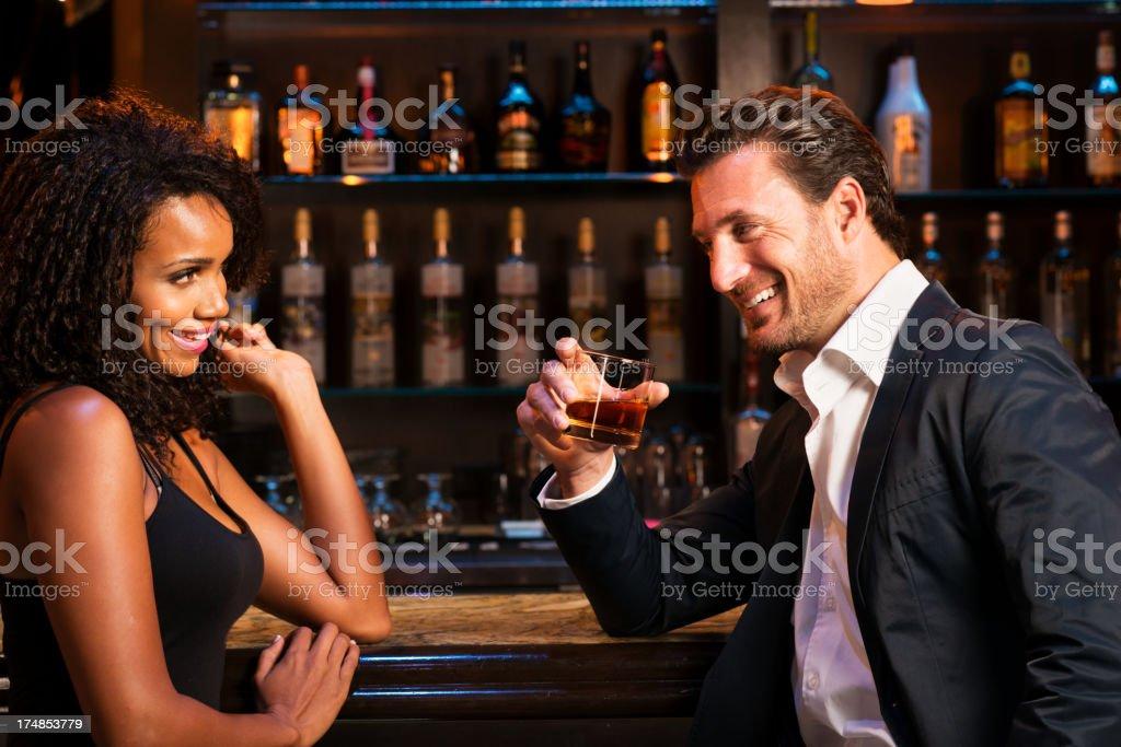 Man with Woman Drinking at Bar stock photo