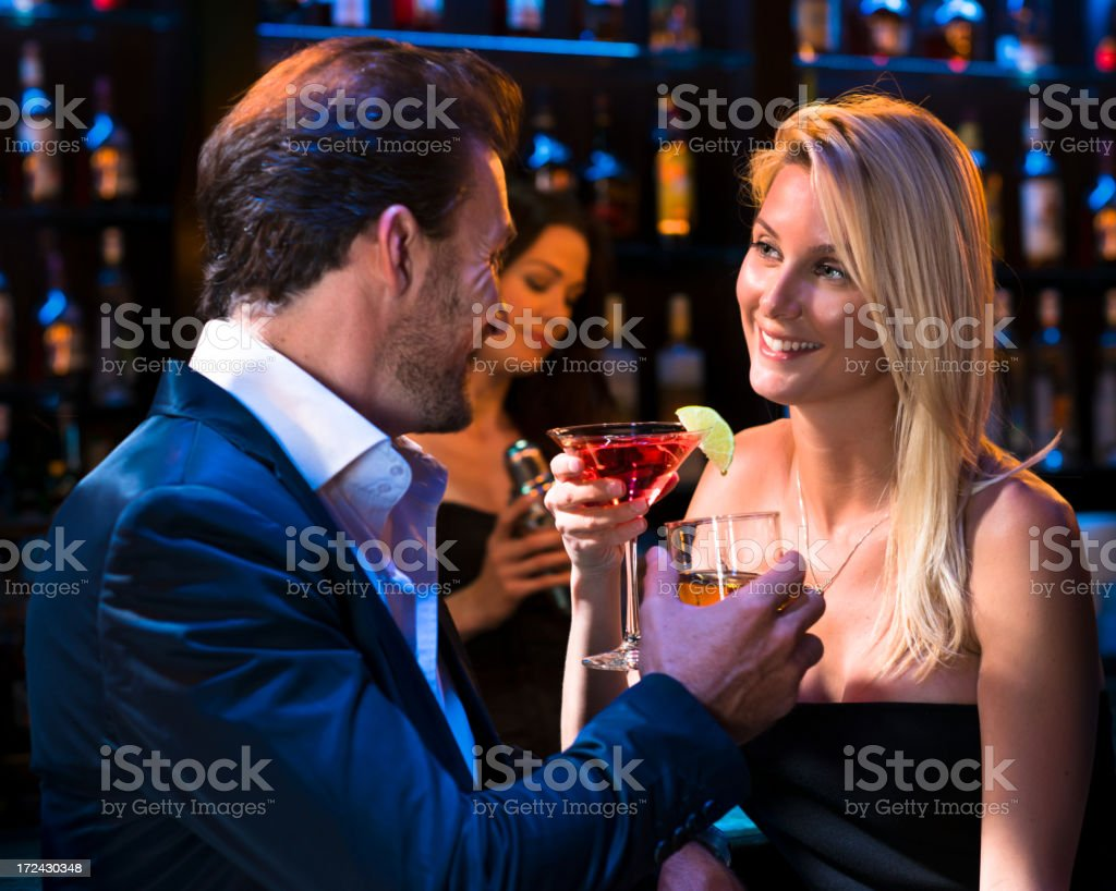 Man with Women drinking Martinis at Bar stock photo