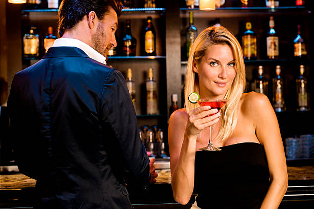Man with Women drinking Martinis at Bar Man with Women drinking Martinis at Bar individual event stock pictures, royalty-free photos & images