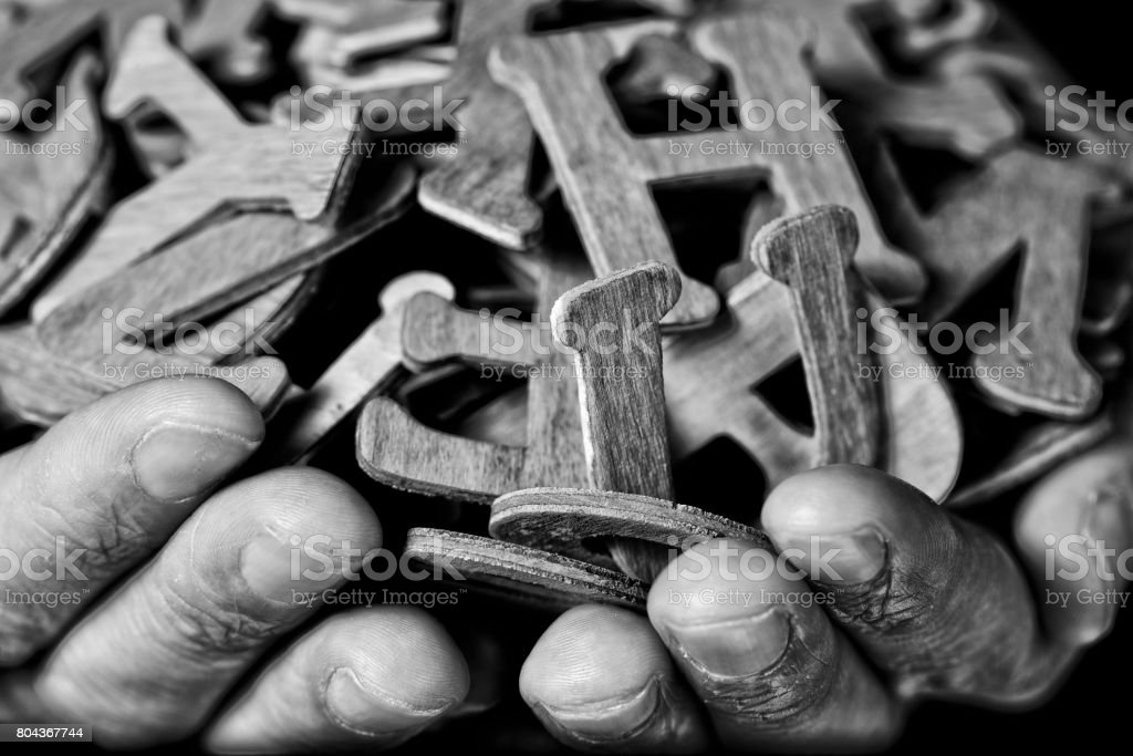 man with wooden letters in his hands stock photo