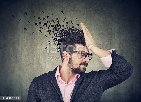 istock Man with worried face expression and many questions 1149137960