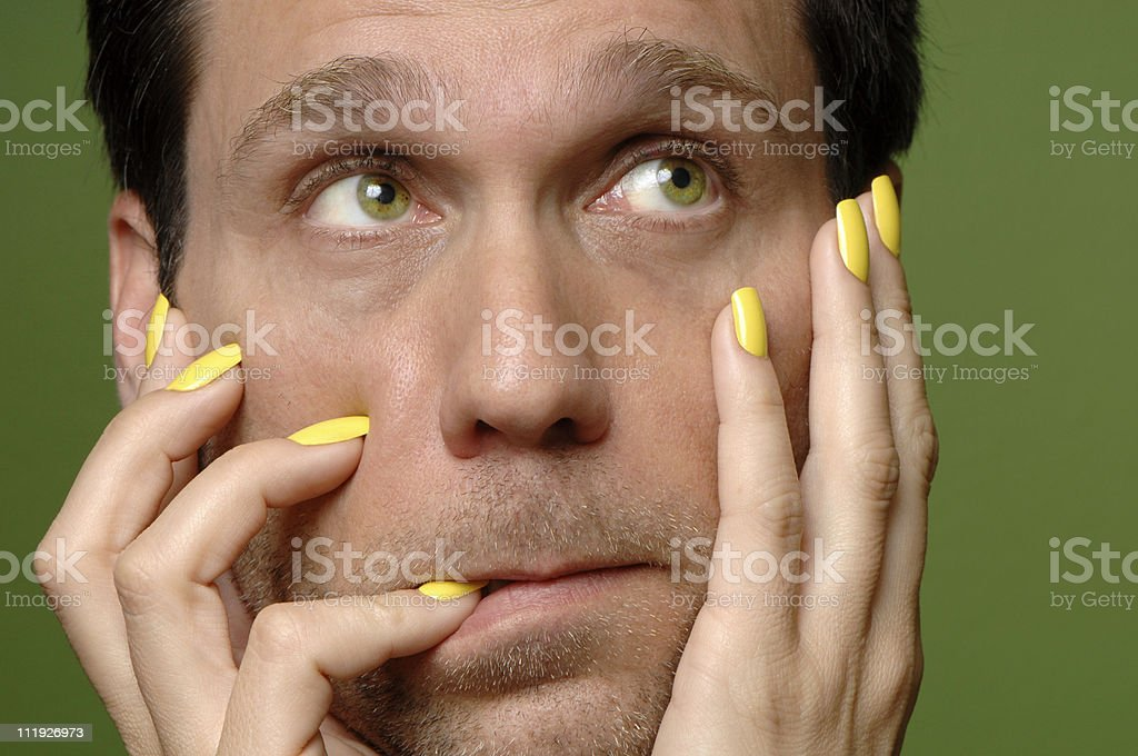 Man with yellow nails stock photo