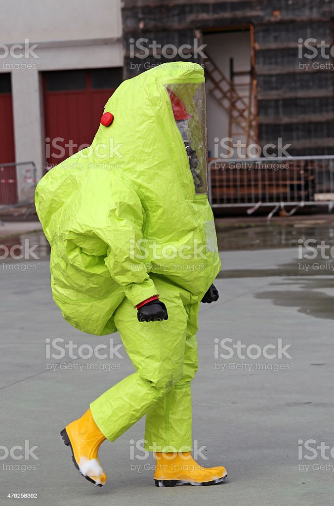 man with yellow protective gear stock photo