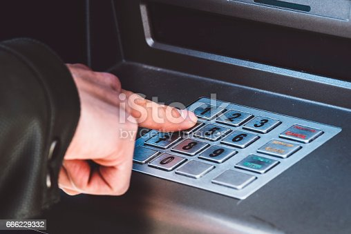 Man Withdraws Money From an ATM in The City