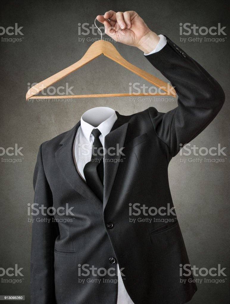 A man without a head with a clothes hanger. stock photo
