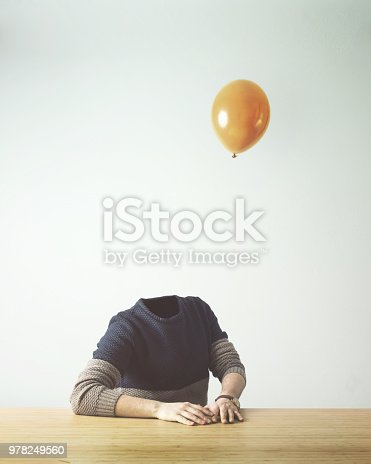 861862204 istock photo man without head obsverving balloon flying away 978249560
