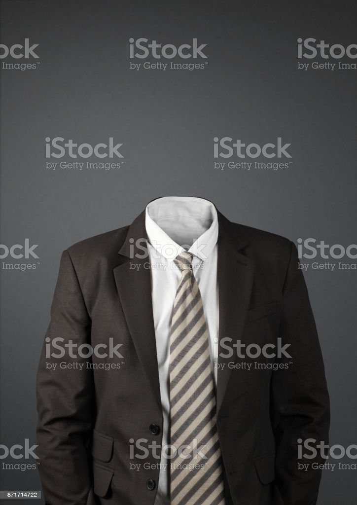 man without head on dark with copy-space stock photo