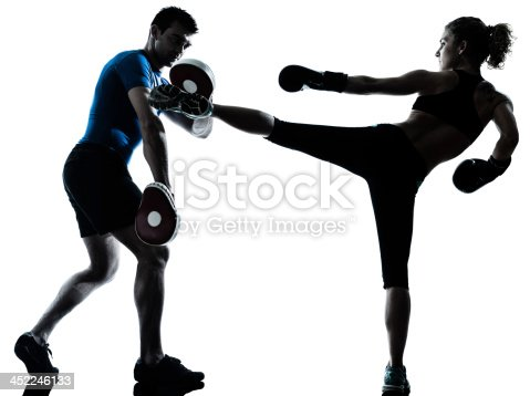 one caucasian couple man woman personal trainer coach man woman boxing training silhouette studio on white background