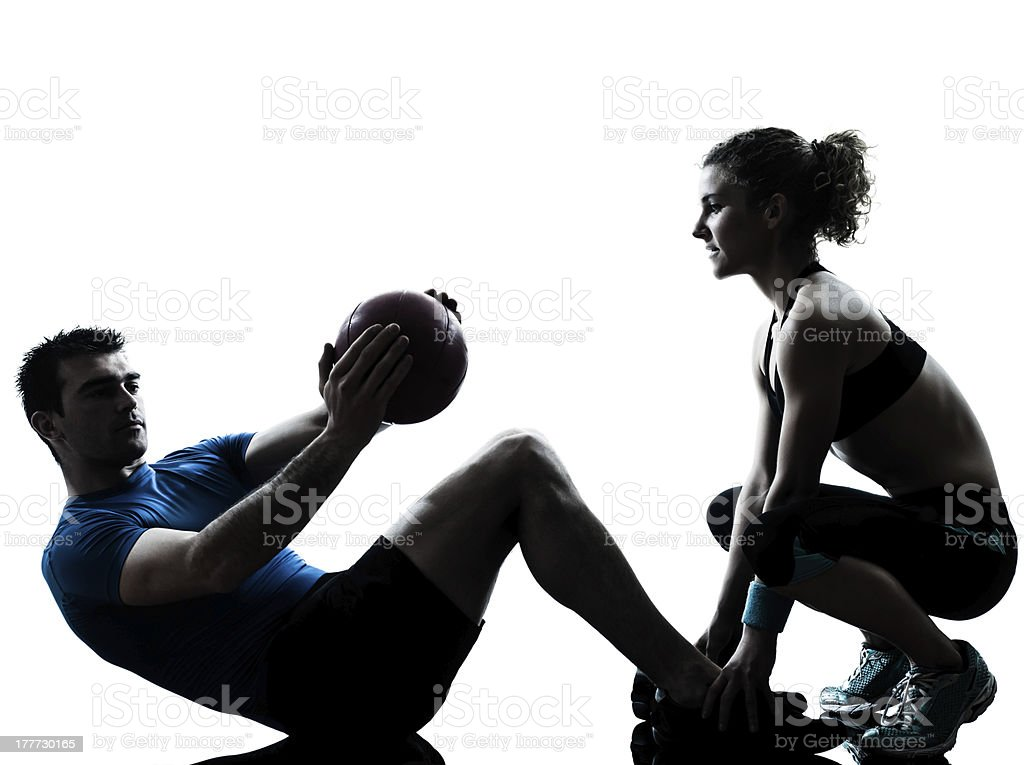 man woman exercising weights workout fitness ball stock photo