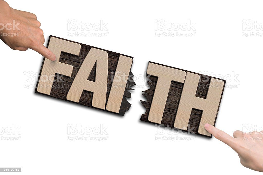 Man woman forefingers combining two cracked FAITH word boards stock photo