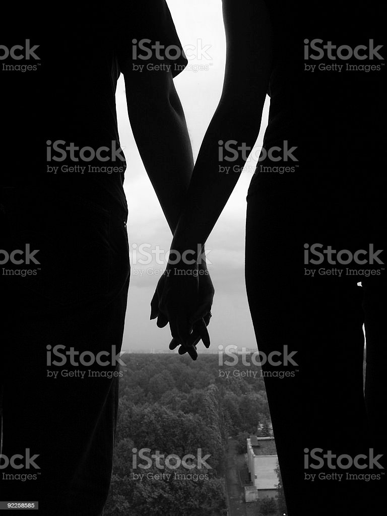 man & woman holding hands stock photo