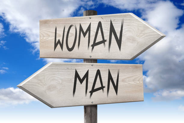 man, woman - wooden signpost - gender stereotypes stock pictures, royalty-free photos & images