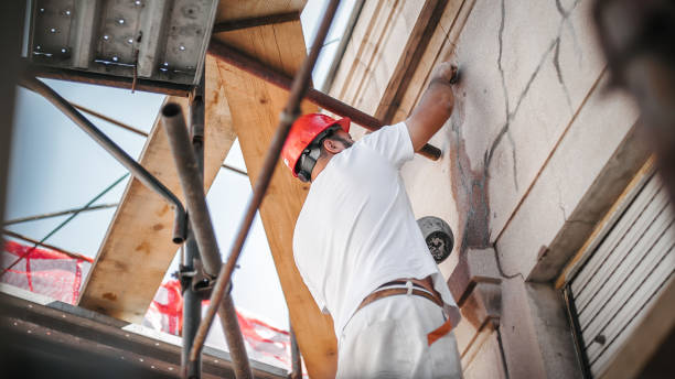 Man worker standing on scaffolding and restore old building facade Man worker standing on scaffolding, perform work on the restoration of the facade of the old building. Repairing and renovate facade stock pictures, royalty-free photos & images