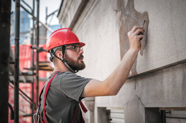 Man worker standing on scaffolding and restore old building facade Man worker standing on scaffolding, perform work on the restoration of the facade of the old building. Repairing and renovate monument stock pictures, royalty-free photos & images