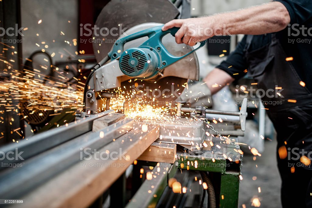 man, worker using a sliding compound mitre saw stock photo