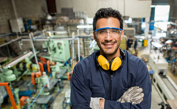 man working at a factory - manufacturing occupation stock photos and pictures